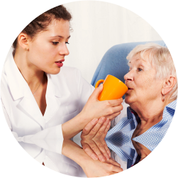 caregiver is giving her patient a medicine